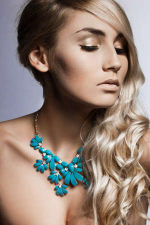 beautiful fashionable woman with jewellry photo