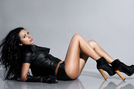 beautiful fashionable woman in leather clothing Stock Photo - 14325206