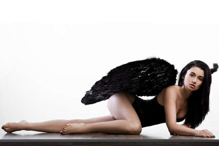 elegance fashion girls look sensuality young: angel with wings in white background Stock Photo