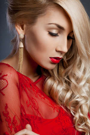 beautiful fashionable woman in red dress photo