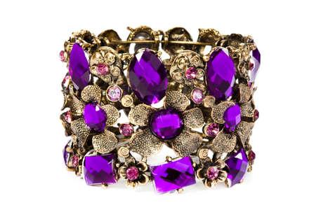 Close-up of violet bracelet isolated on white background photo
