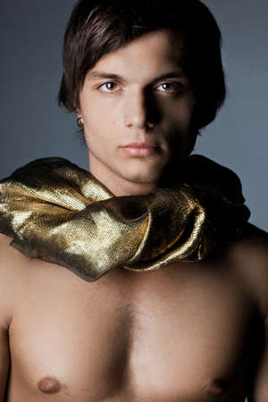 young man in golden scarf photo