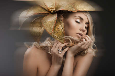 portrait of woman with golden flower Stock Photo - 15531601