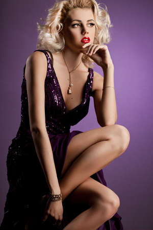 beautiful fashionable woman in violet clothes photo