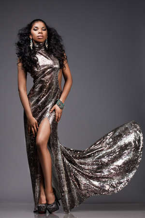 beautiful fashionable woman in silver dress photo