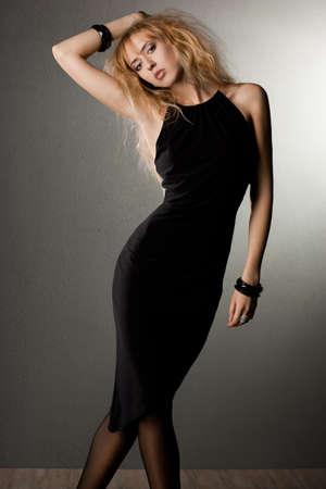 beautiful fashionable woman in black dress photo