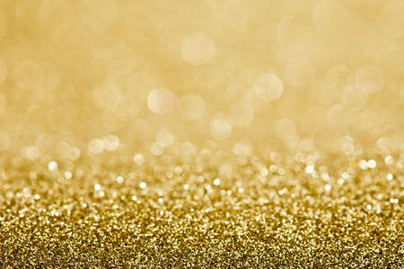 golden  gleam: Abstract holidays lights on background  Stock Photo