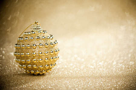 Christmas ball on sparkles background photo