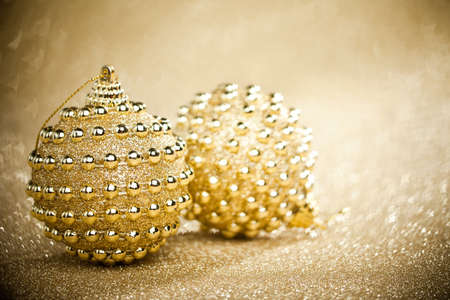 Christmas balls on sparkles background photo