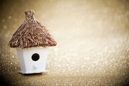 thatched: house with a thatched roof on a festive background Stock Photo