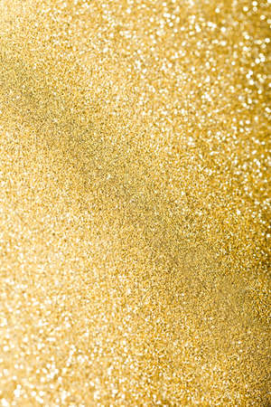 glitter sparkles dust on background, shallow DOF photo
