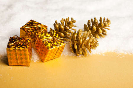 Christmas decoration gift boxes with pinecone and snow photo