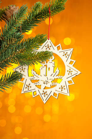 branch of Christmas tree with decoration star photo