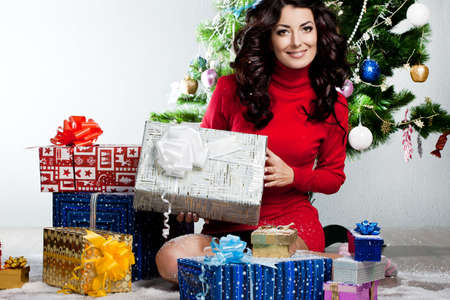 beautiful fashionable woman with gift boxes photo