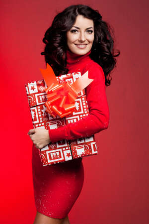 beautiful fashionable woman with gift box photo