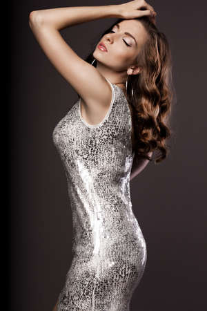 beautiful woman in silver dress photo