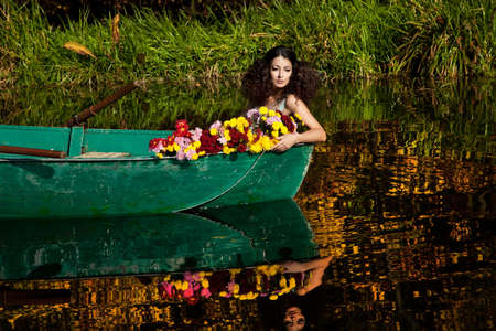 woman on a boat in the autumn photo