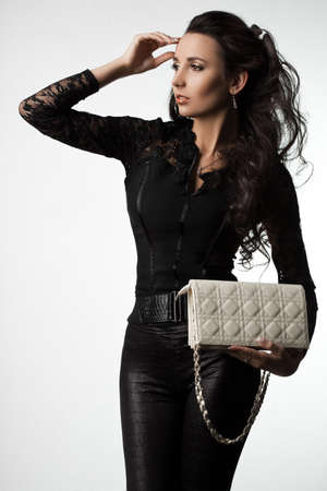 beautiful fashionable woman with handbag photo