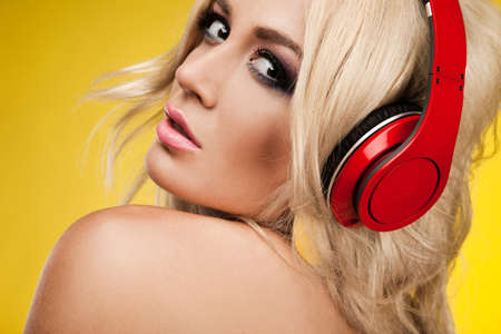woman in lingerie with headphones photo