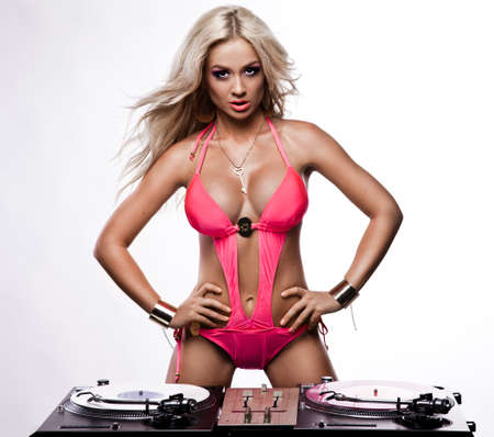 Woman in lingerie with DJ setup Stock Photo