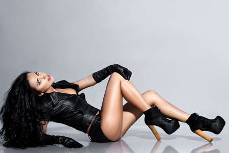 beautiful fashionable woman in leather clothing photo