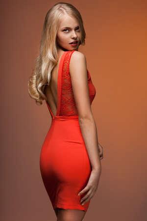 beautiful woman in orange dress Stock Photo