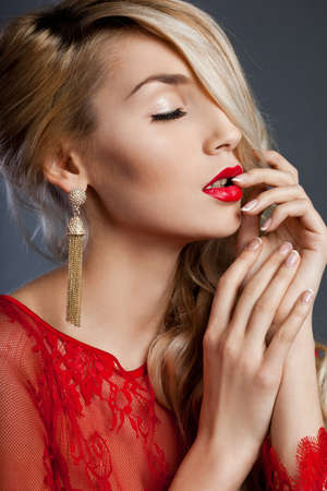 beautiful fashionable woman with ear-rings photo