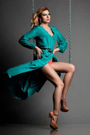 beautiful fashionable woman in blue dress photo
