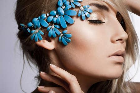 beautiful fashionable woman with jewellry photo