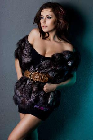 beautiful woman in grey fur photo