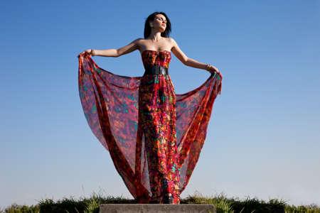 beautiful woman in red dress photo
