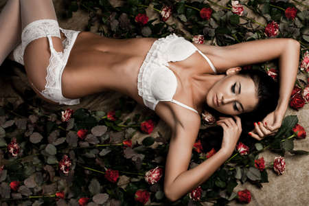 beautiful fashionable woman in lingerie with roses photo