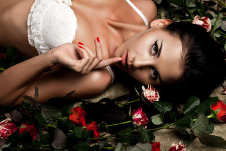 beautiful fashionable woman in lingerie with roses Stock Photo