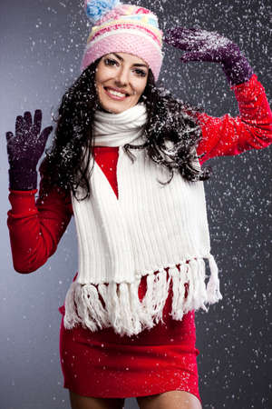 beautiful fashionable woman with snow Stock Photo