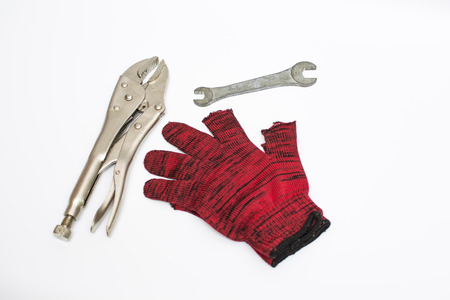 hand tools & glove for work. Clamping pliers for holding tough fasteners tight. hand tools isolated on white background.