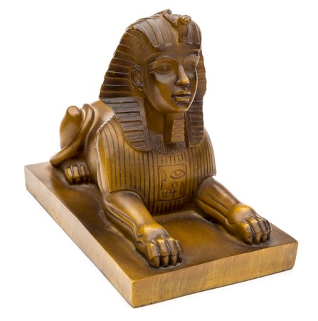 antiquities: figurine of a sphinx on a white background