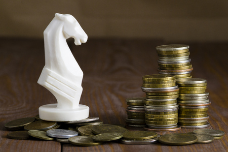standoff: coins and white horse Stock Photo