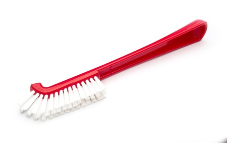 red plastic brush on white background