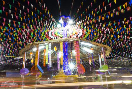 roundabout: Songkran festival Buddha statue roundabout light trails