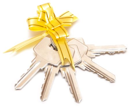 bunch of keys with yellow bow is isolated on the white photo