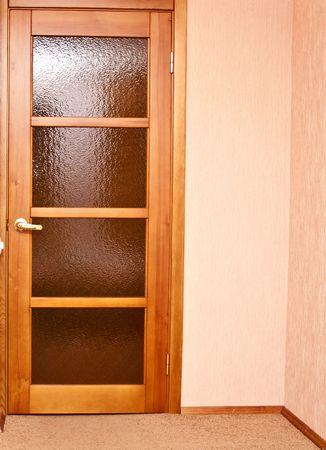 wooden door with yellow glass in room photo