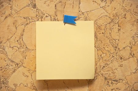 yellow tacks: sticky leaf for records is attached to wall by dark blue tag Stock Photo
