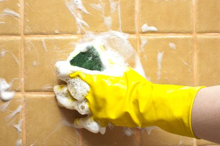 soapy: hand in yellow rubber glove holding soapy cleaning sponge