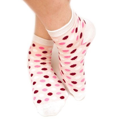 feet of the woman in sock peas on white background Stock Photo - 7594457
