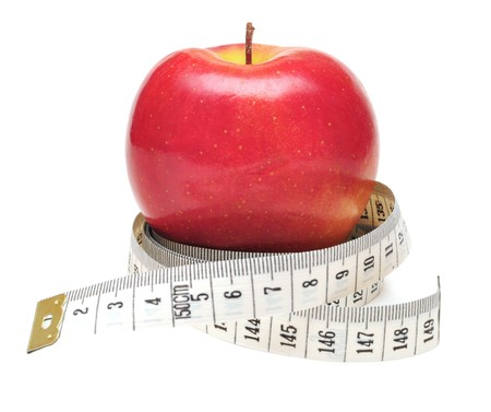 tape measure wrapped around red apple isolate on white Stock Photo - 7594610