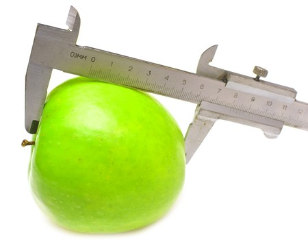 measured: green apple measured is isolated on white