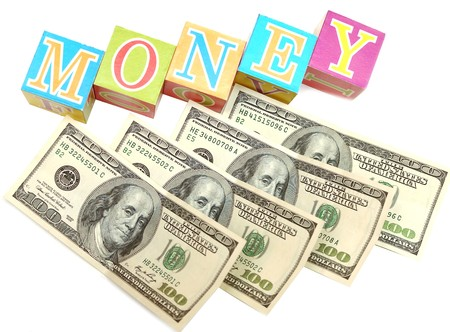 childrens toy letter building blocks against a white background money photo