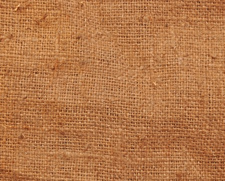 textured background of a sandy brown burlap cloth  photo