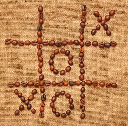 game tic toe laid out coffee beans on photo