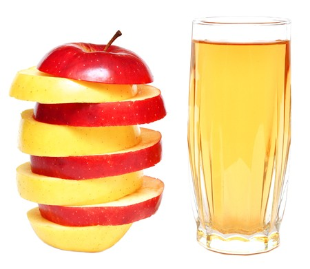 apple juice in glass and fresh apples on white background photo